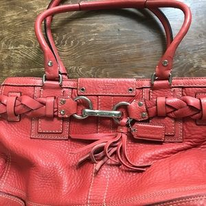 Coral pebbled leather Coach handbag